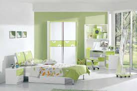 white wooden bed with green head board combined with white green