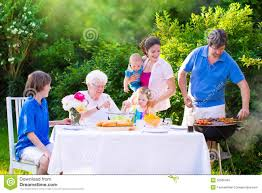 Family In The Garden Big Happy Family Enjoying Bbq Grill In The Garden Stock Photo