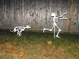 halloween yard skeletons dog skeletons chasing person