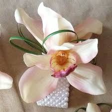 orchid wrist corsage pink orchid wrist corsage cymbidium orchids in light pink