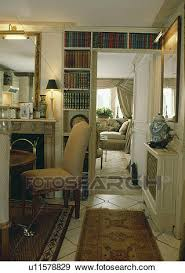 stock photograph of bookshelves over door in small dining room