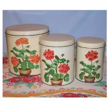 metal kitchen canisters vintage metal kitchen canisters with geraniums