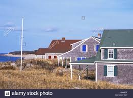 scenic view of multi color cape cod beach houses in dennis stock
