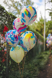 love these tie dye balloons at a carnival party via www