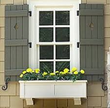 split level addition home design taupe window and brown