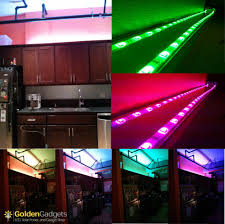 12v water resistant color changing led strip light 150 x 5050 rgb led strip light installed over kitchen cabinets in downtown la loft