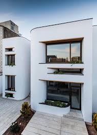 white modern house with curved surfaces in isfahan stands out from