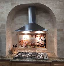 vineyard mural installed above stove in this neat stone arched