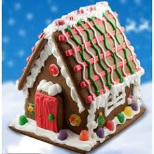 red and green house with ice cycles gingerbread houses