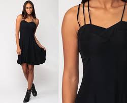 black mini dress 80s strappy mini cage skater criss cross
