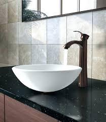 unique bathroom sink faucets bathroom with grey stone walls and