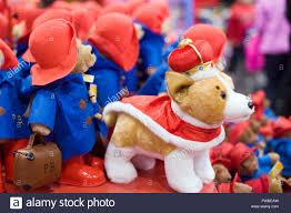 The Queen S Corgi Paddington Bear And The Queens Corgi Wearing A Crown Soft Toys