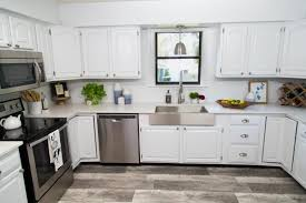 how to paint stained kitchen cabinets white paint your kitchen cabinets without sanding or priming diy