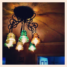 recycled chandeliers home made glass insulator chandelier for the home pinterest