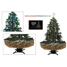 christmas tree with green umbrella base snow falling christmas
