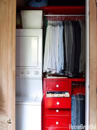 one side of this closet houses a compact washer and dryer set