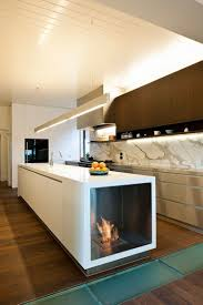 kitchen kitchen island fireplace with wood flooring also pull