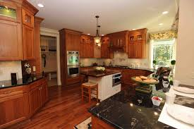 acrylic vs wood kitchen cabinets kashiori com wooden sofa chair