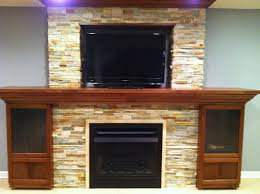 stacked stone entertainment center and fireplace by link