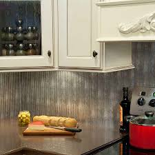 decorating artistic fasade backsplash with white kitchen cabinets modern kitchen design with silver fasade backsplash plus white cabinets and countertop for home ideas