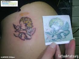 small baby with bird design tattoos book 65 000