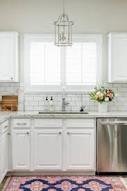 subway tiles for kitchen backsplash chic white kitchen features white cabinets paired with white