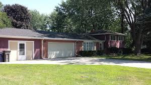 rental homes huge 2 car garage with bonus 1 car sized garage with workshop area attached