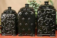 black ceramic kitchen canisters tuscan design black scroll fleur de lis ceramic kitchen