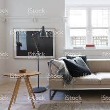 scandi styled living room in art deco australian apartment stock