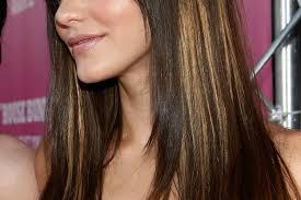 shades of high lights and low lights on layered shaggy medium length hair brown lowlights highlights underneath blonde medium hair