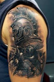 the best shoulder tattoos designs accurate painted colored shoulder tattoo of gladiator fight with
