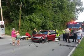 woman with feet on dashboard survives wreck painful lesson