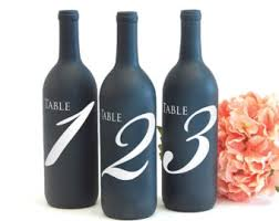 gold wine bottle table numbers table number wine bottle gold glitter wedding by gethappydesign