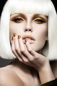 beautiful in a white wig with gold makeup and nails