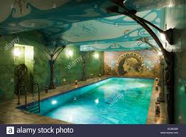 indoor swimming pool decorated with water coloured art nouveau