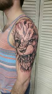 graphic stylized lion by me logan bramlett wanderlust tattoo