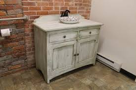 how to repaint bathroom cabinets faux painted bathroom cabinets portia double day painted