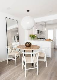 Round White Kitchen Table Iron by Round Wood Top Dining Table With White Wishbone Chairs