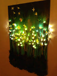 made this diy light up branches on painted canvas craftiness