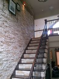 Faux Stone Post Sleeves by Airstone For That Dramatic Wall Of Stone Going Up The Staircase