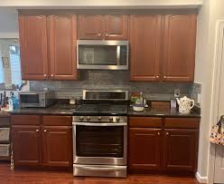 how to refinish cherry wood cabinets advice on what color to refinish paint my kitchen cabinets