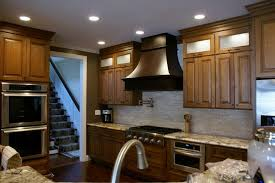 lighting design for kitchen wood range hood oseries omega national island range hoods