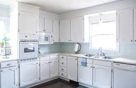 white kitchen cabinets refinishing my painted cabinets two years later the the bad the