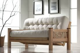 modern living room design with comfortable white king size futon