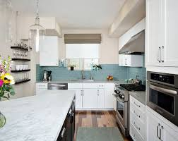 small kitchen designed with white cabinets and grey subway tile