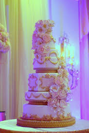 white gold and purple wedding gold regal wedding cake cascading blooms