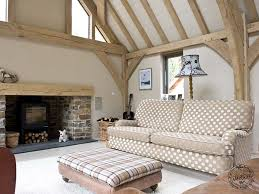 oak framed living room interior with open fire place