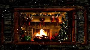 christmas fireplace window scene with snow and crackling fire