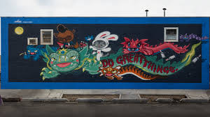 designed on surface luck dragon mural graces wall in brooklyn download in hi res