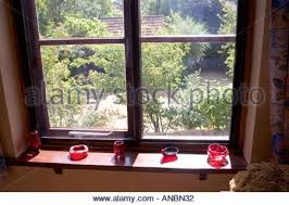 cut glass ornaments on window sill stock photo royalty free image